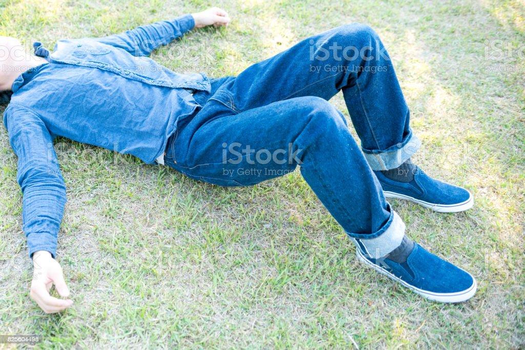 Man lying on the gren field stock photo