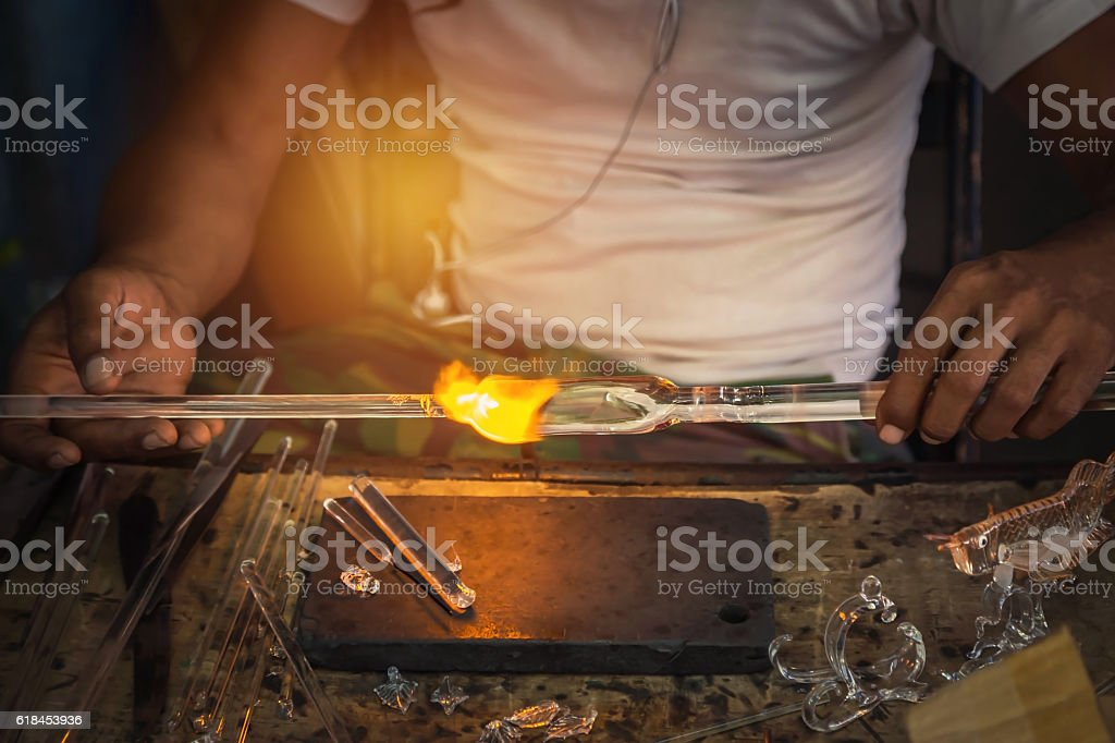 man made hand craft from glass blowing with fire blower stock photo