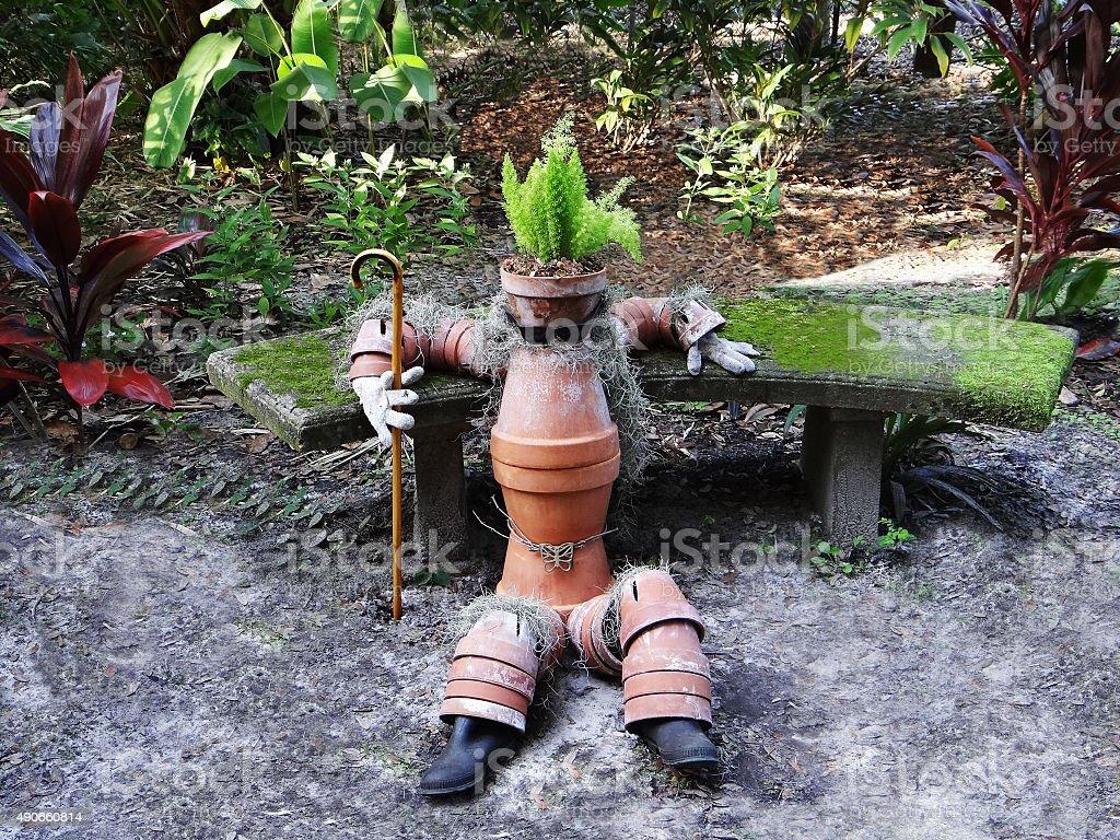 Man made of clay pots stock photo