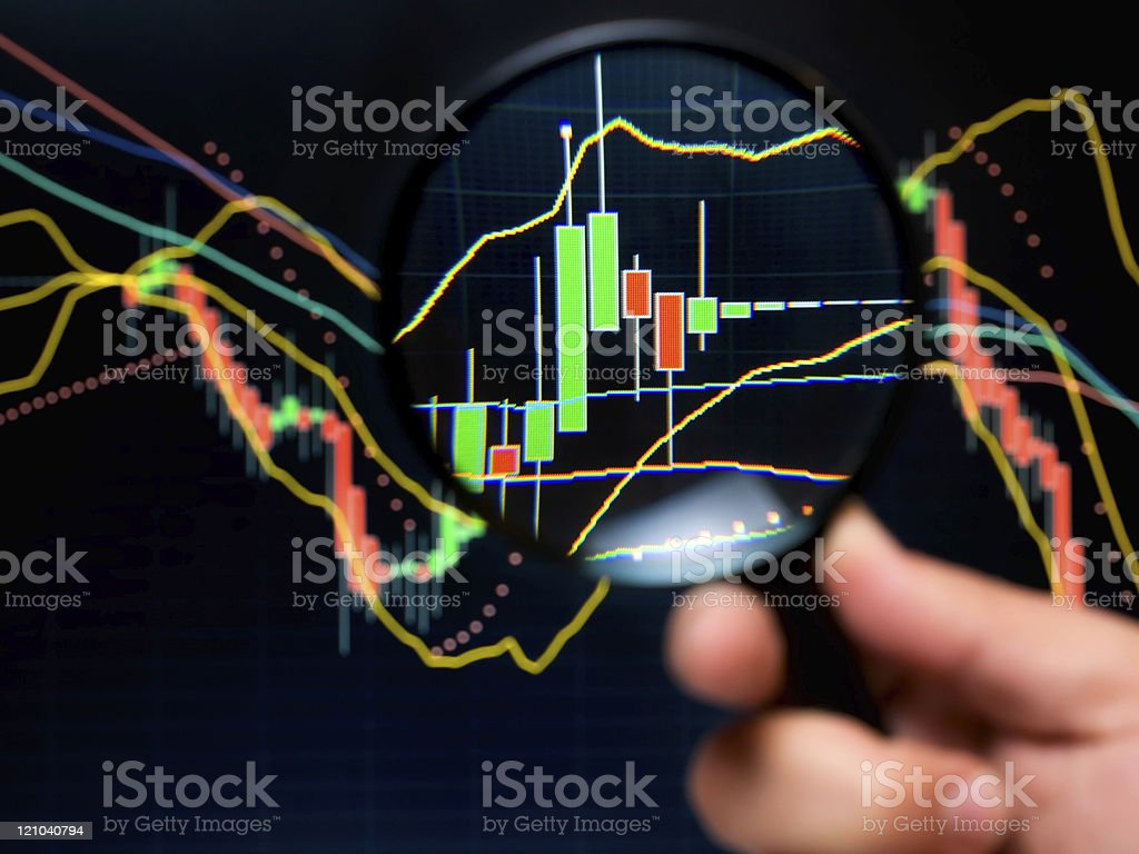 A man magnifying a stock analysis graph royalty-free stock photo