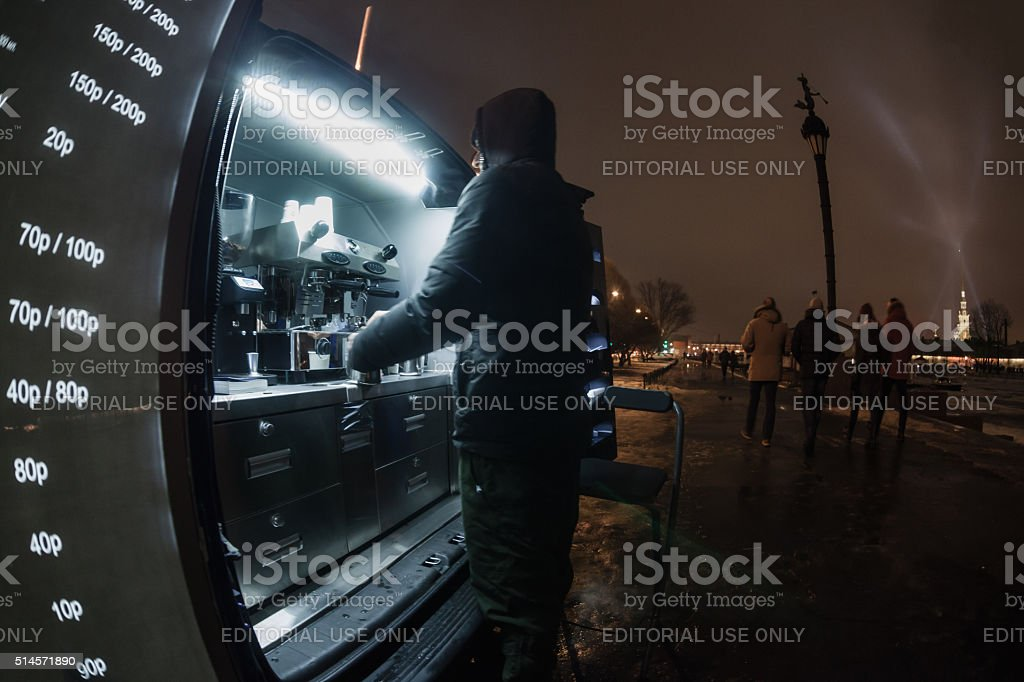 Man makes a coffee in a mobile coffeehouse stock photo