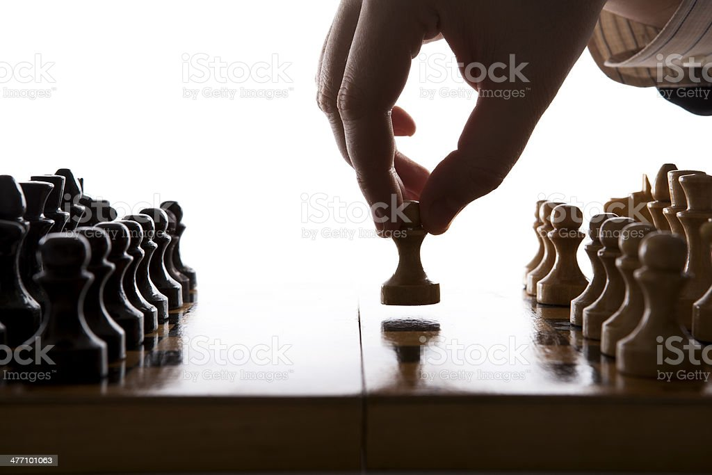 man makes a move chess pawn stock photo