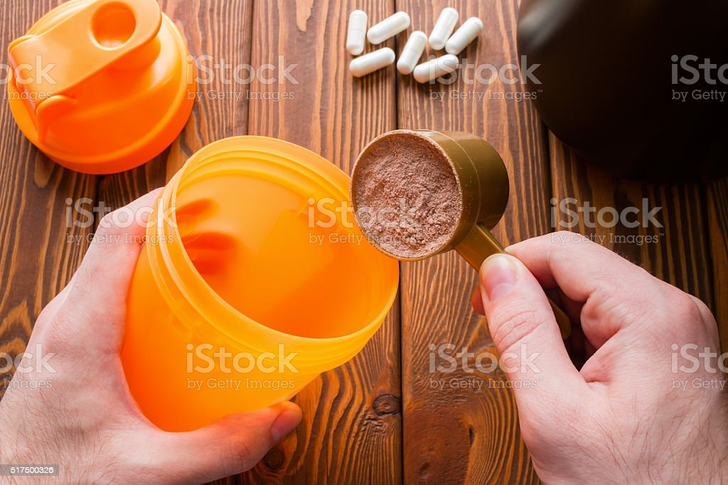 man makes a protein cocktail after a workout stock photo