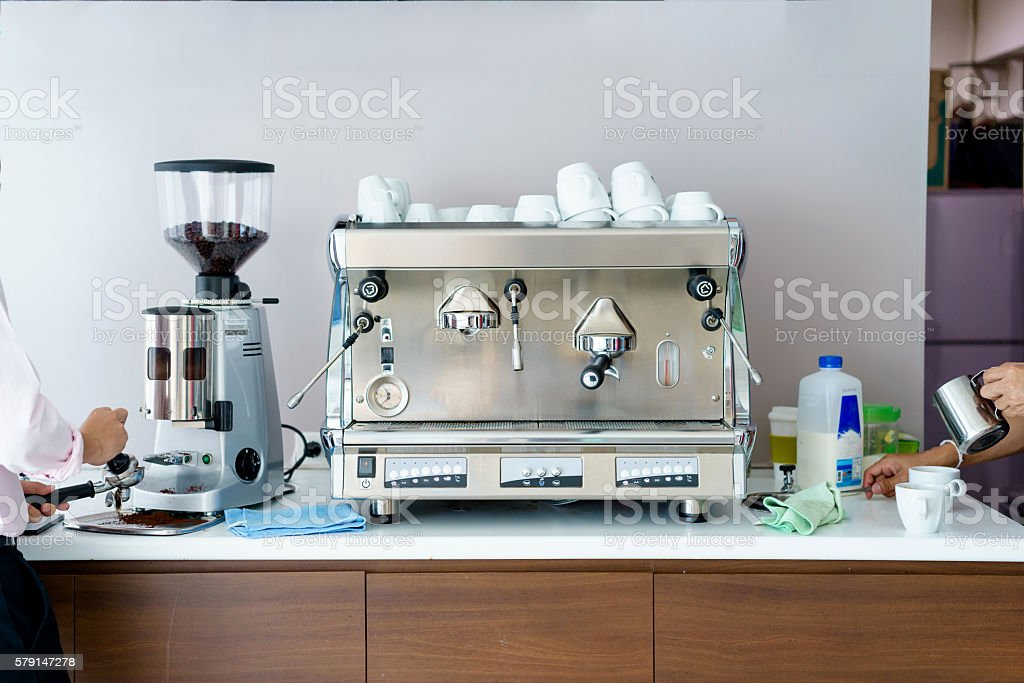 Man makes coffee with a machine stock photo