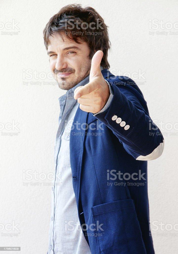 Man Makes Gun Gesture stock photo