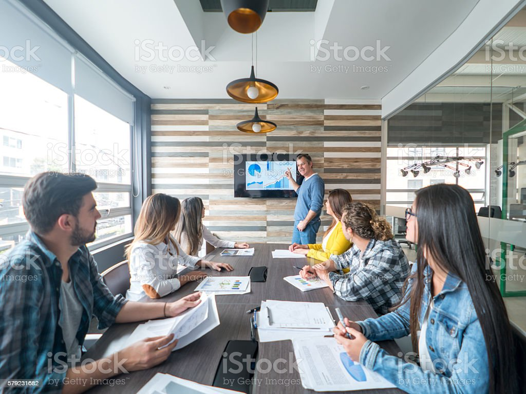 Man making a business presentation stock photo