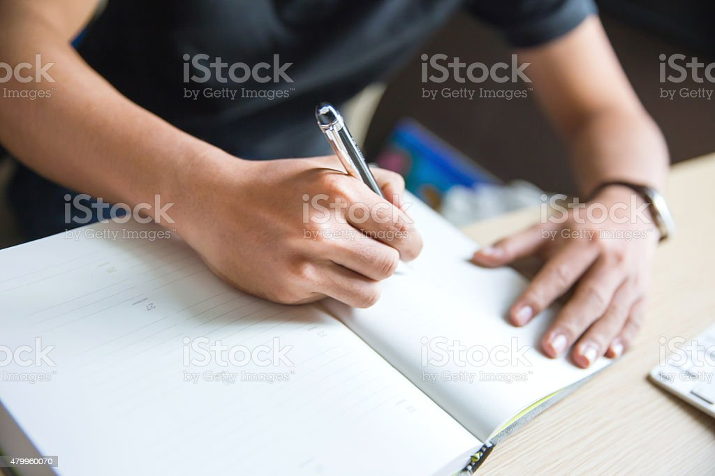 Man making a business schedule stock photo