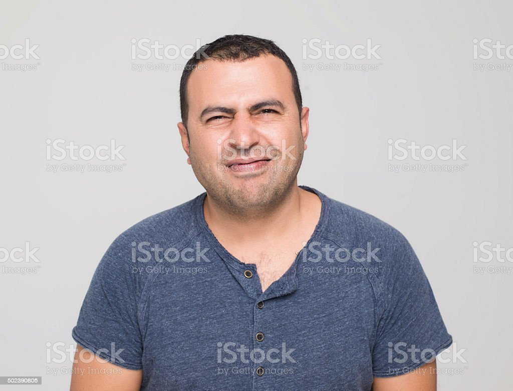 Man making a disgusting face expression stock photo