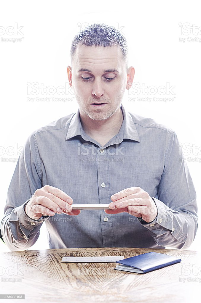 Man making a mobile deposit with his cell phone stock photo