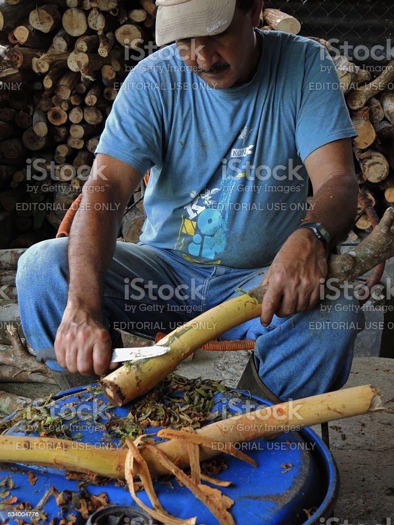 Man Making Cinnamon Strips stock photo