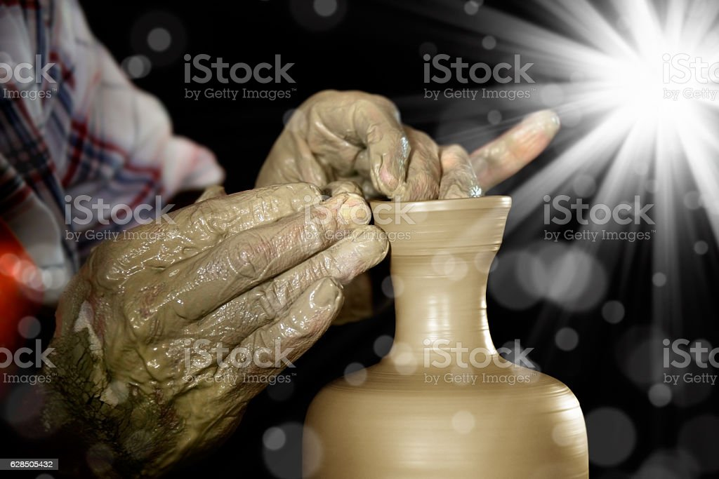 Man making clay pot stock photo
