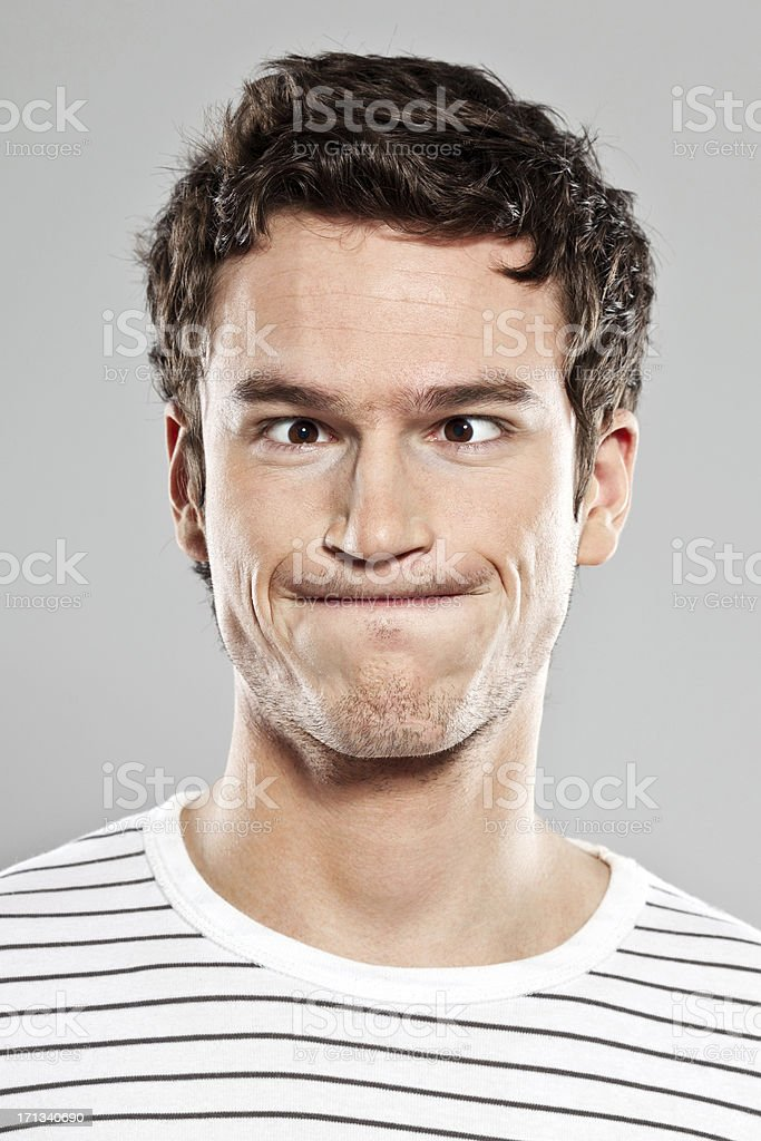 Man making face stock photo
