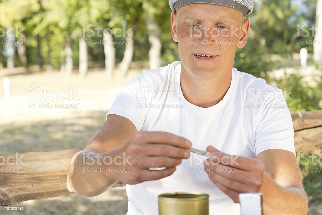 Man making himself a joint or cigarette royalty-free stock photo