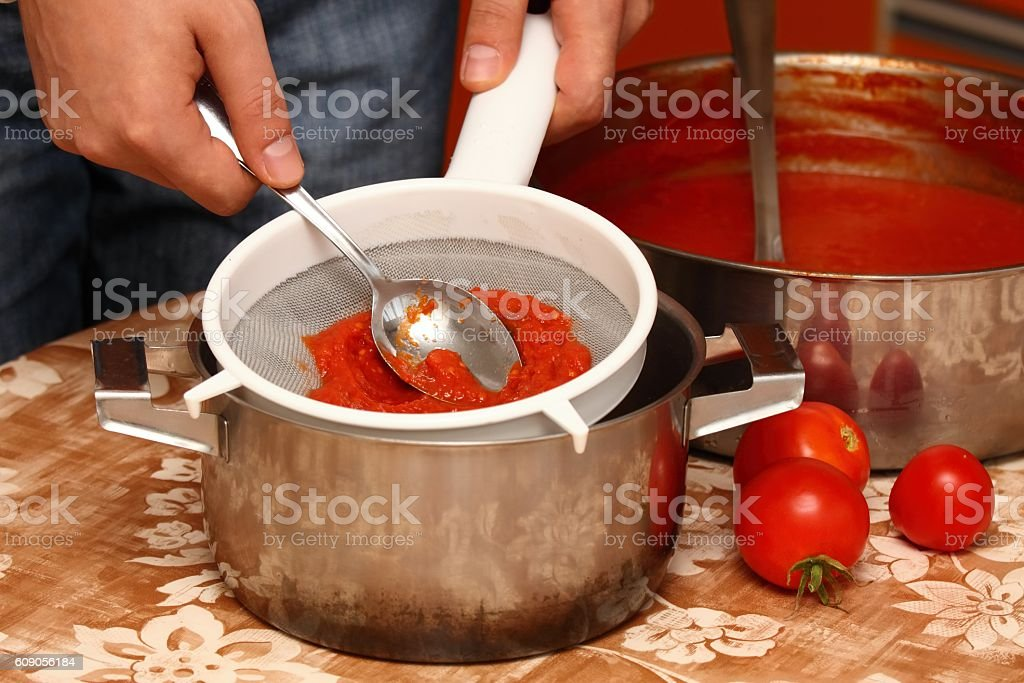 Man making ketchup stock photo