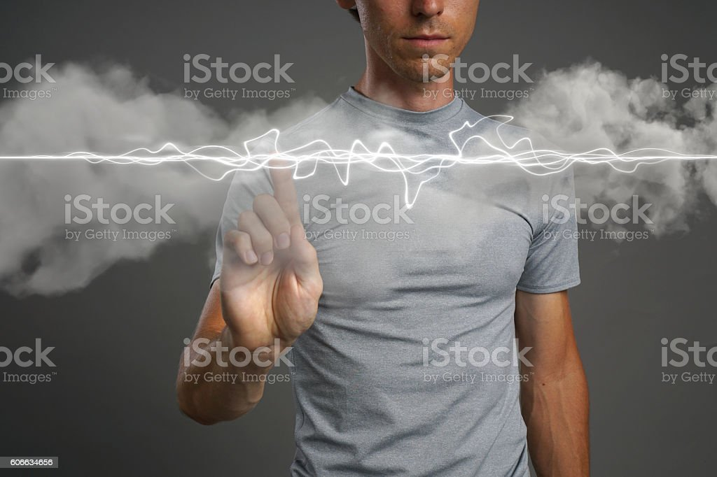 Man making magic effect - flash lightning. The concept of stock photo
