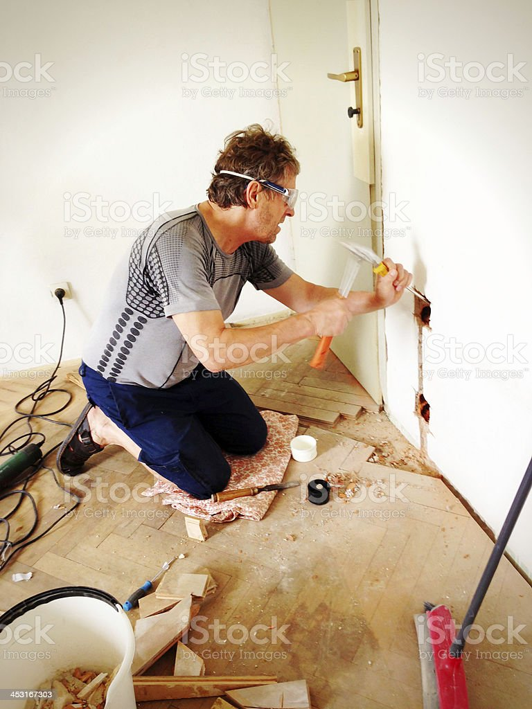Man Making New Plugs During Home Addition royalty-free stock photo