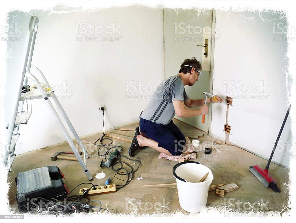 Man Making New Plugs During Home Addition stock photo