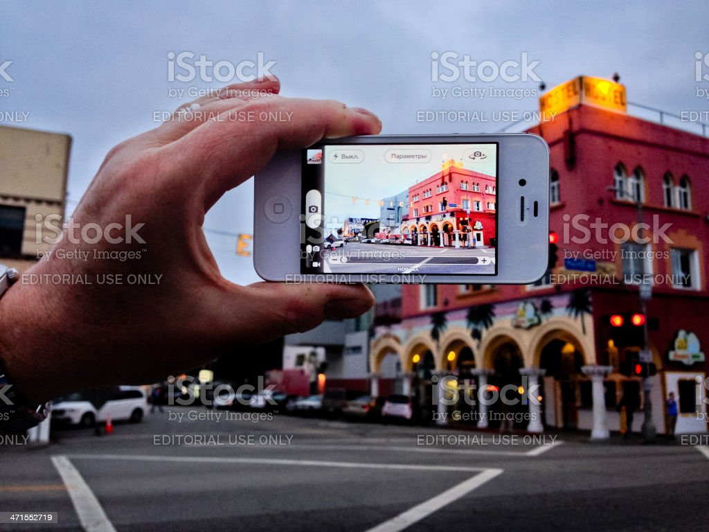 Man making photo of Venice Sign with iPhone royalty-free stock photo