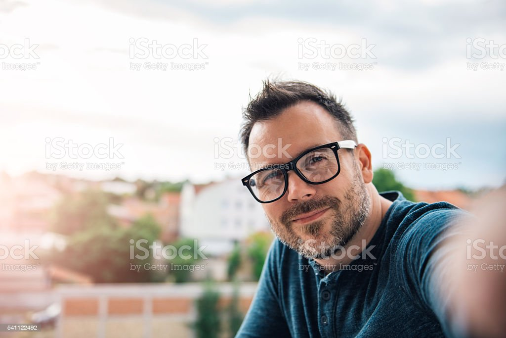 Man making selfie outdoor stock photo