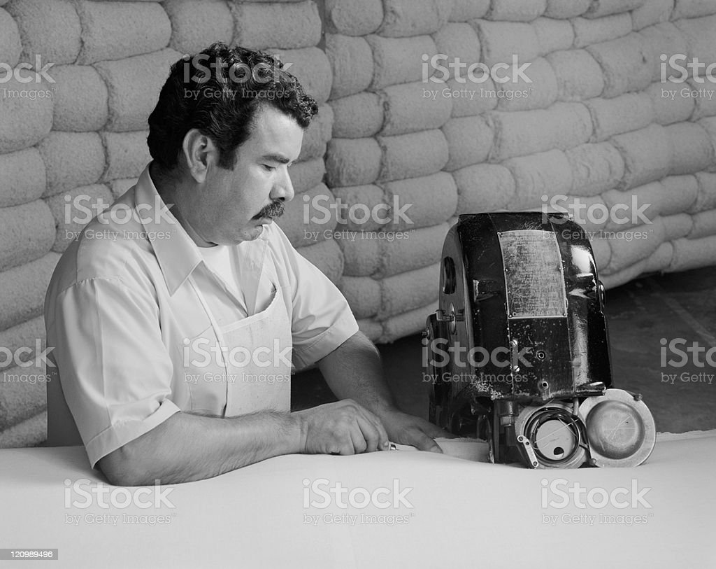 Man manufacturing duvet in factory royalty-free stock photo