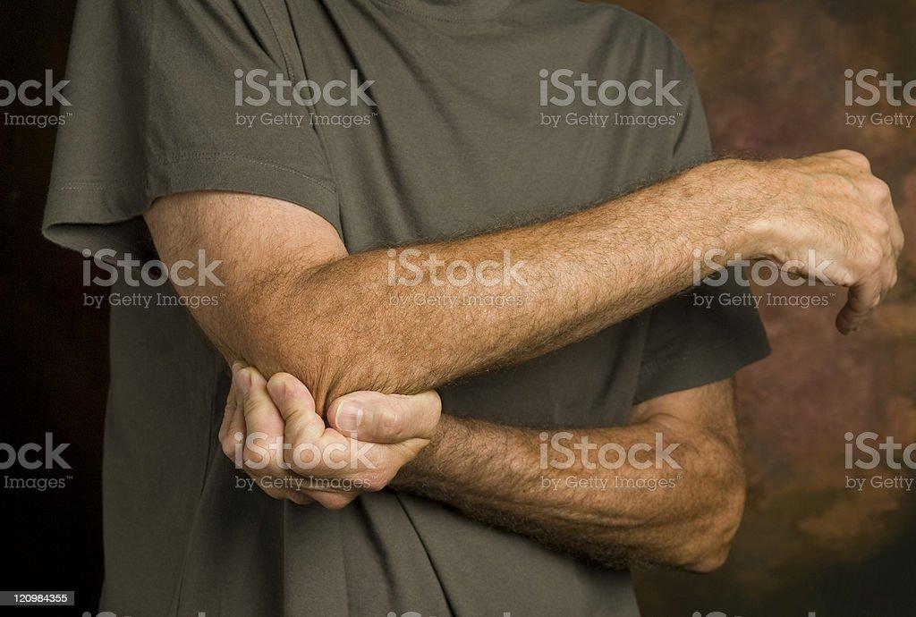 man massaging elbow in pain_2 stock photo
