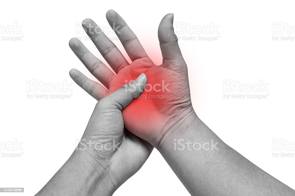 Man massaging his painful hand isolated on white stock photo