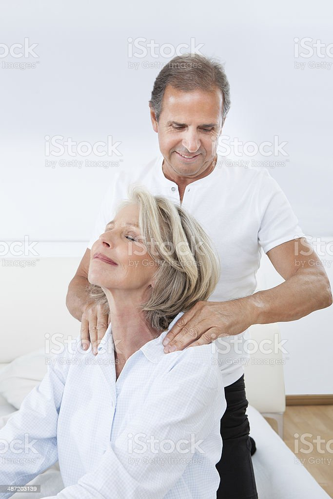 Man Massaging Woman's Shoulder stock photo