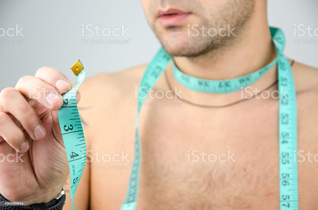man measured his neck stock photo