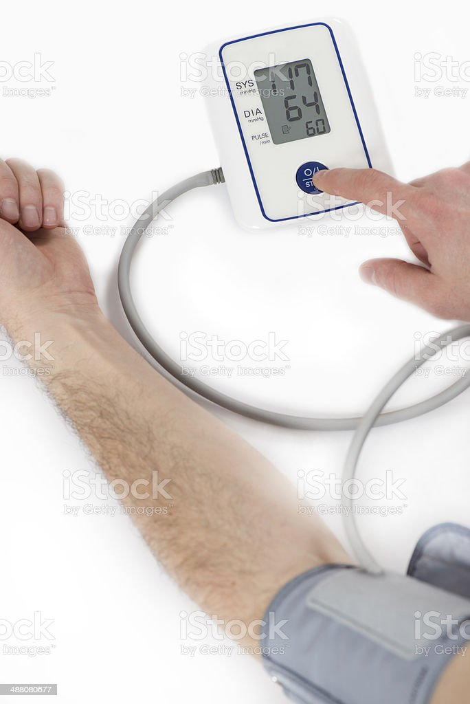 Man measuring his own blood pressure. royalty-free stock photo