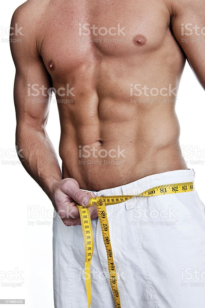 Man measuring his waist royalty-free stock photo