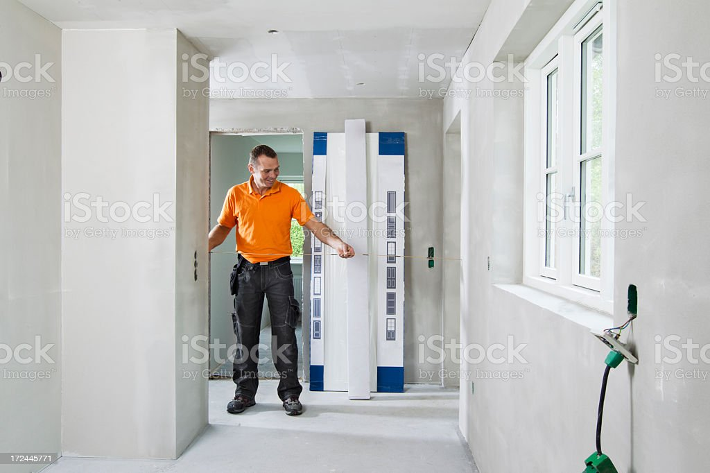 Man measuring in room royalty-free stock photo
