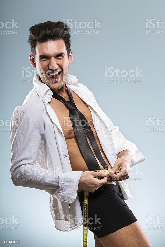 Man measuring while getting dressed stock photo