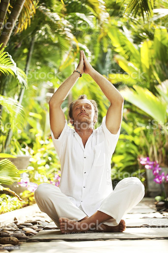 Man meditating in a tropical resort. royalty-free stock photo