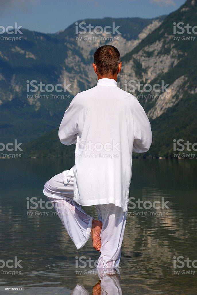 Man meditating in water royalty-free stock photo