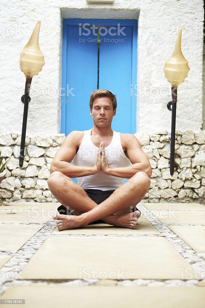 Man Meditating Outdoors At Health Spa royalty-free stock photo