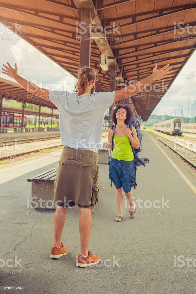 Man meeting his girlfriend at the train station stock photo