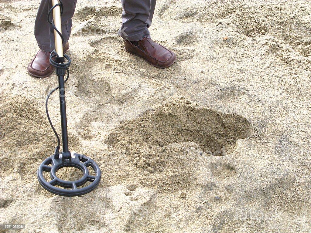 Man Metal Detecting On Beach royalty-free stock photo