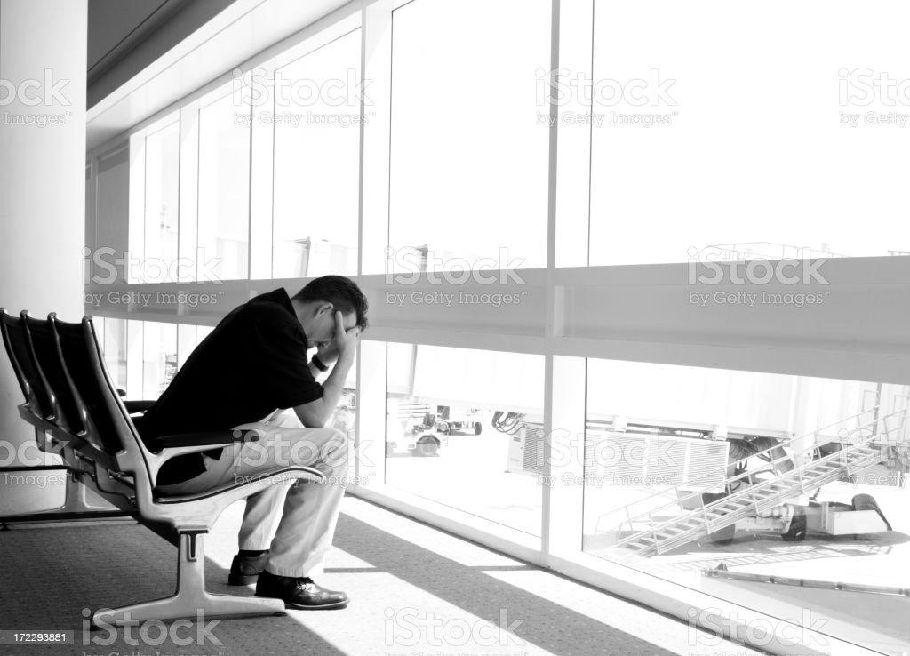Man misses flight at airport--horizontal royalty-free stock photo