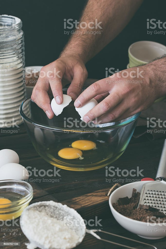 Man mixes ingredients for cooking chocolate cake stock photo