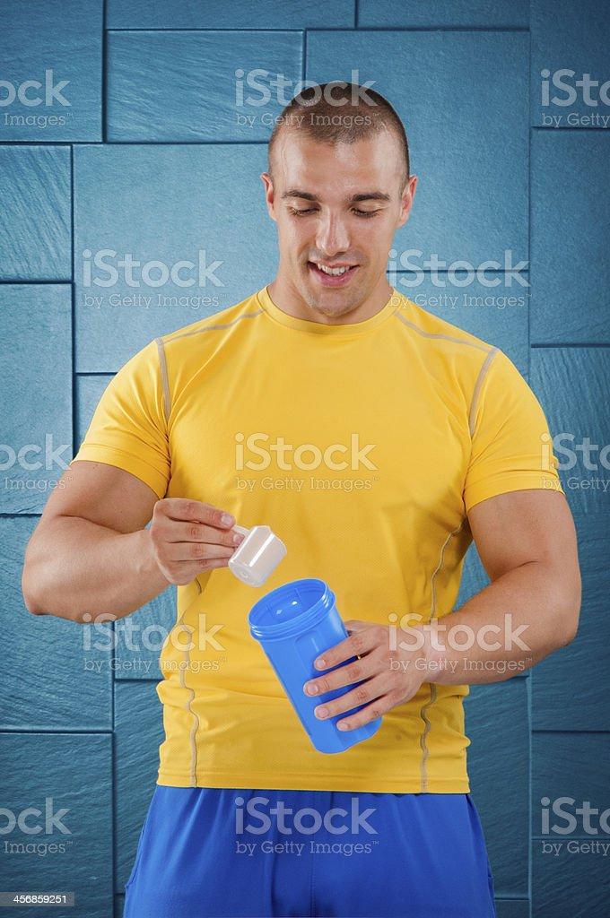 Man mixing powdered protein royalty-free stock photo