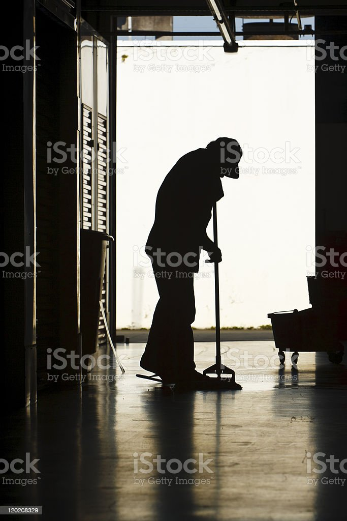 Man mopping factory floor royalty-free stock photo