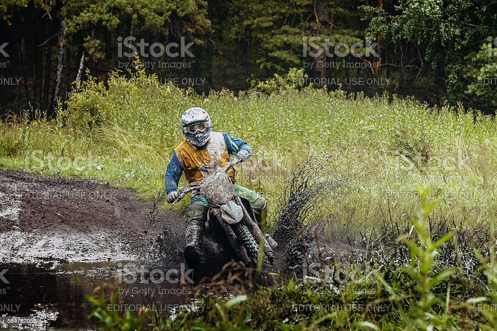 man motorcycle racing Enduro in forest royalty-free 스톡 사진