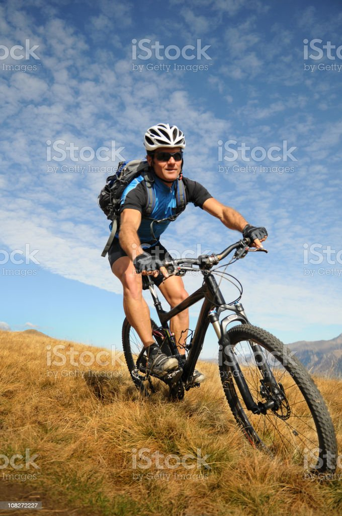 Man Mountain Biking in mountains royalty-free stock photo