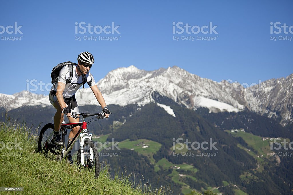 Man mountain biking in the mountains royalty-free stock photo