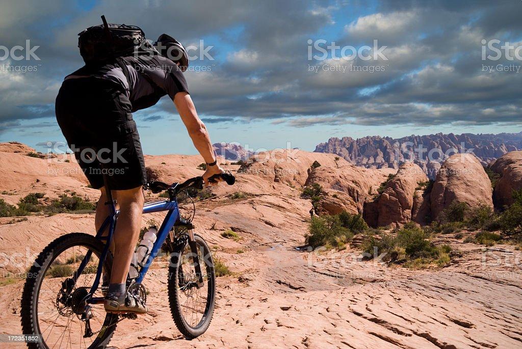 Man mountain biking on the Slickrock Trail in Moab, Utah stock photo