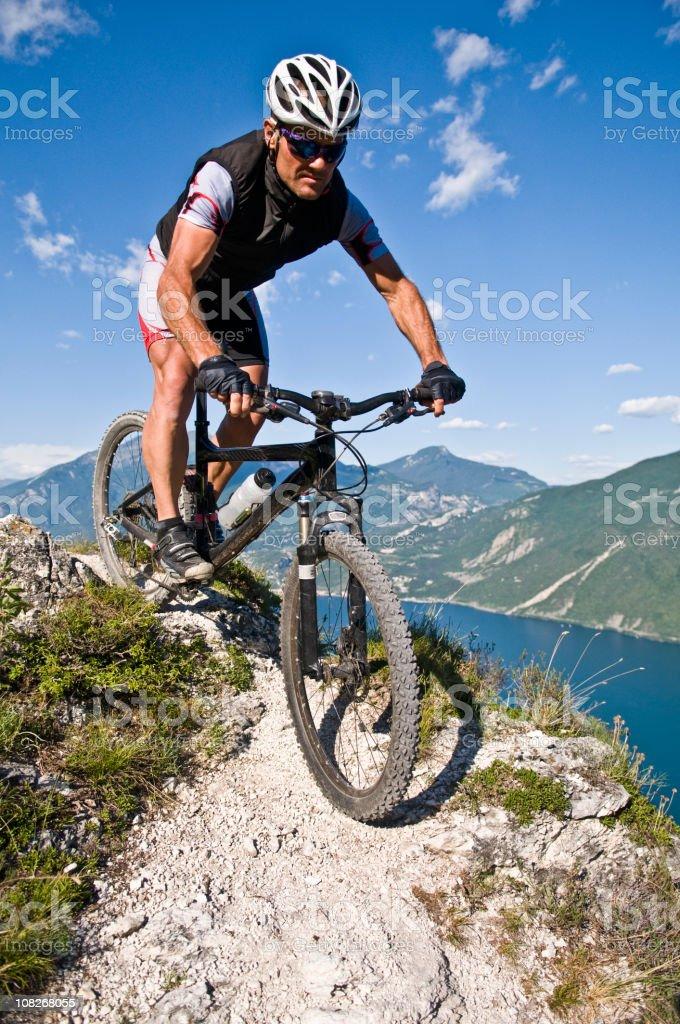 Man Mountain Biking on Trails Above Lake royalty-free stock photo