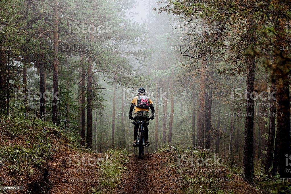 man mountainbiker rides on a sports  bicycle stock photo