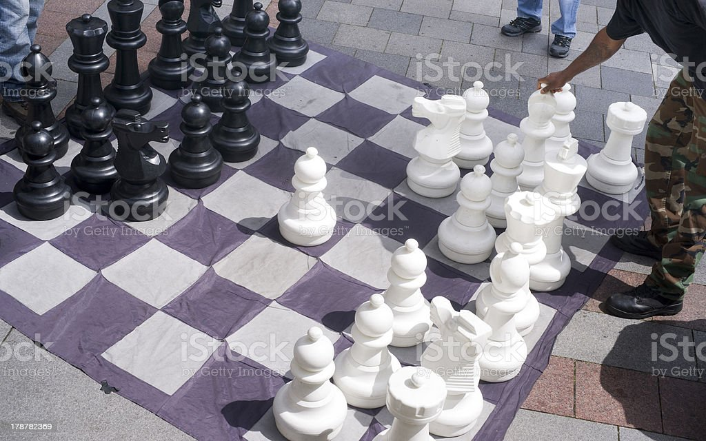 Man Moves Piece People Playing Giant Chess Game Sidewalk Downtown stock photo