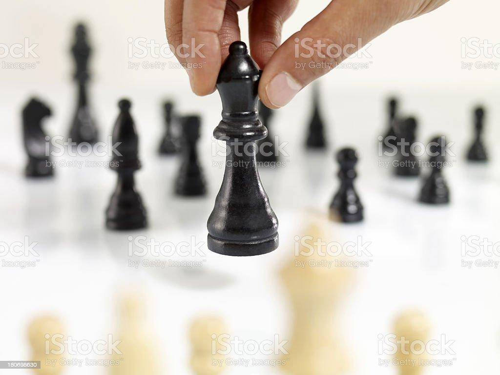 Man Moving Chess Figure stock photo