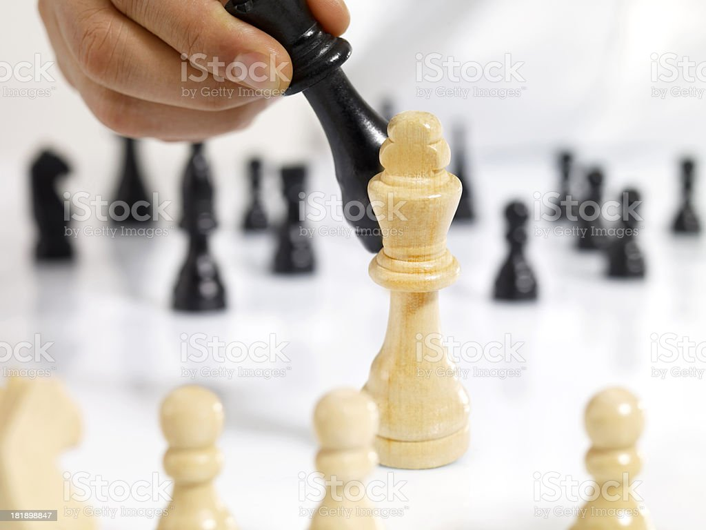 Man Moving Chess Figure royalty-free stock photo
